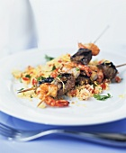 Beef and prawn kebabs on couscous