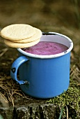 Mug of blueberry shake and biscuits