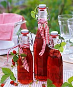 Wild strawberry vinegar decorated with fresh wild strawberries