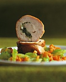 Rolled veal roast on carrots and celery