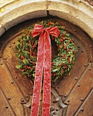 Christmas door wreath with holly berries