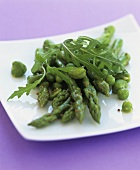 Green asparagus with peas, beans and rocket