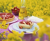 Strawberry flan, rapeseed oil & oilseed rape field in background