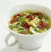 Savoy cabbage soup with paprika sausage