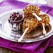 Chicken with nut crust and cranberry dip