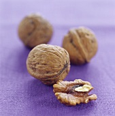 Walnuts on purple background