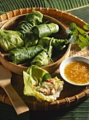 Stuffed lettuce leaves with orange dip (Vietnam)