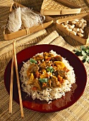 Braised beef on deep-fried rice noodles (Vietnam)