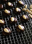 Chocolate-coated apricot drops with almonds