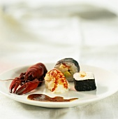 Nigiri sushi, maki sushi and cooked freshwater crayfish