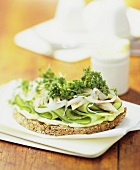 Smoked fish, cucumber slices and cress on wholegrain bread