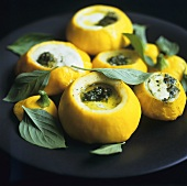 Patty pan squashes with mozzarella and pesto stuffing