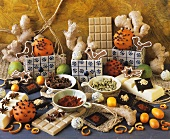 Still life with chocolate, spices and studded oranges