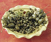 Capers and caper berries on a plate