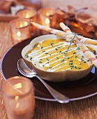 Cream of pumpkin soup and ham-wrapped grissini
