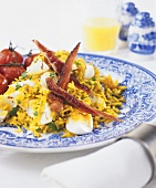 Pan-cooked rice dish with egg and bacon