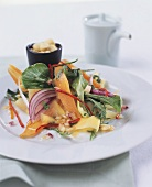 Mixed salad with carrots, pak choi and mango slices