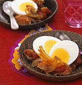 Boiled eggs on a bed of onion