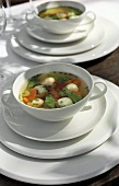 Chicken broth with vegetables, chicken- and prawn dumplings