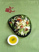 Rice salad with vegetables and pine nuts