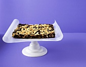 Chocolate cake with meringue and flaked almonds