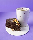 Chocolate cake with hazelnuts, beaker of tea