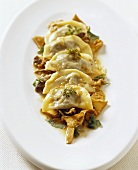 Ravioli with black chanterelle filling and chanterelles