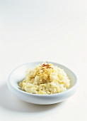 Rice pudding with flaked almonds and saffron