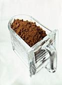Cocoa powder in glass container