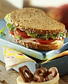 Ham, lettuce, tomato and cress sandwich (multi-grain bread)