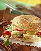 Chicken breast, radishes and mayonnaise in bagel