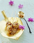 Chicken skewers with lychees and peanut dip