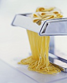 Running pasta through a pasta maker