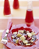 Campari and chocolate sauce with cherries and pasta
