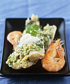 Fish with herb crust and prawns