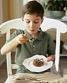 Boy eating chocolate soufflé