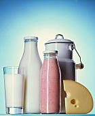 Glass of milk, bottle of milk, milk can, cheese & strawberry milk