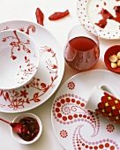 Red and white place-setting with pomegranate juice