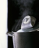 Pan of boiling water and kitchen timer