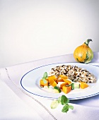 Pumpkin and courgettes with sauce and rice
