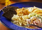 Raw vegetable salad with sesame vinaigrette and black bread