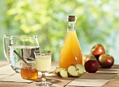 Still life with cider vinegar, honey and apples
