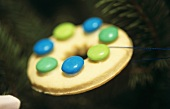 Biscuit with coloured chocolate beans to hang on the tree