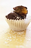 Chocolate-coated apricot marzipan sweet