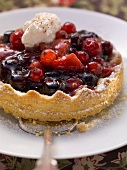 Red berry tart with spiced coffee cream
