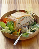 Salmon and zander strudel with honey, mustard and dill sauce on salad
