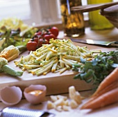 Courgette sticks on wooden board