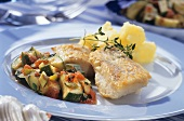 Zander fillet with courgettes and tomatoes