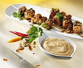 Spicy turkey kebabs with peanut sauce