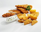 Chicken escalopes with potato wedges and herb remoulade sauce